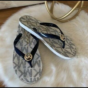 Brand new Michael kors flip flops